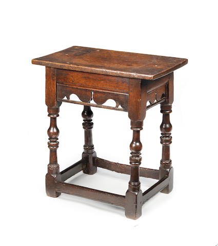 A rare James I oak joint stool  Circa 1610