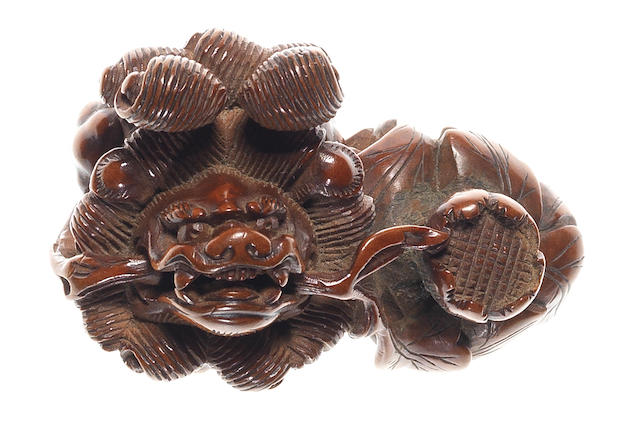 A fine boxwood netsuke of a shishi 19th century