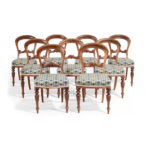 A set of ten Victorian walnut balloon back dining chairs (10) made by Eadon and Son, Sheffield