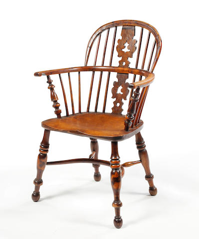 A 19th century yew and elm low Windsor armchair Attributed to Nottinghamshire