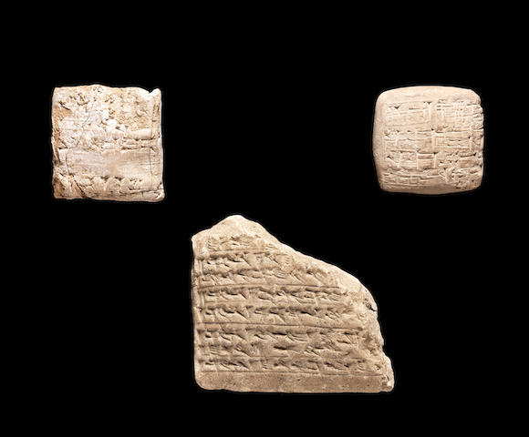 A Mesopotamian terracotta cuneiform envelope containing a tablet (5 in total split from 98) two Mesopotamian terracotta cuneiform tablets; 3