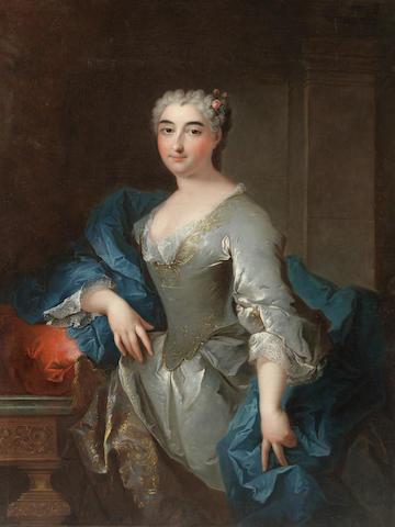 Robert Levrac-Tournières (Caen 1667-1752) Portrait of a lady, three-quarter-length, in a blue silk dress and a floral headdress, unframed