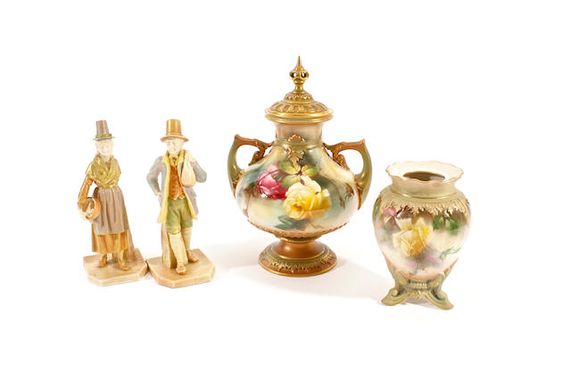 A pair of Royal Worcester figures of a Welsh man and woman, a Royal Worcester vase and a cover and a Hadley's vase, late 19th/early 20th century
