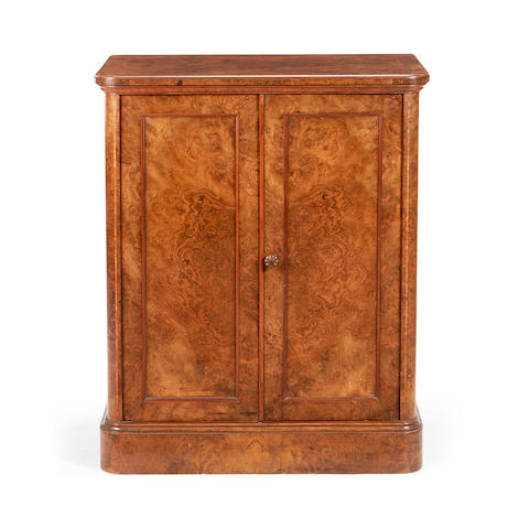 A Victorian burr walnut and tulipwood banded cupboard by Holland and Sons