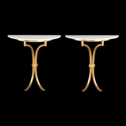 A pair of gilded iron console tables  After an Adam Williams design