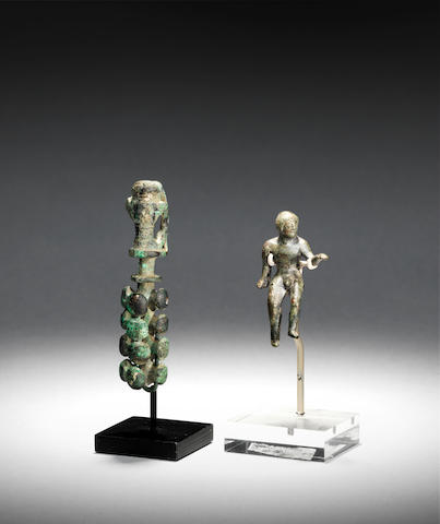 A Greek bronze finial  and an Etruscan bronze figure, 2