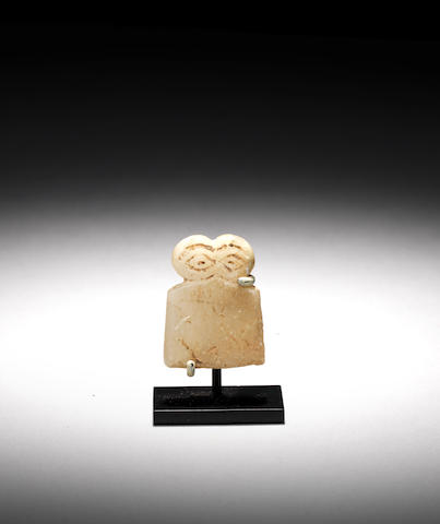 A Syrian alabaster eye idol