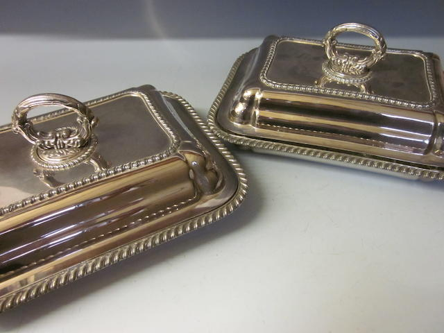 A pair of Old Sheffield plate dishes and covers