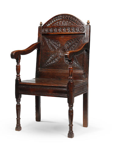 A Charles I oak panel back open armchair West Country