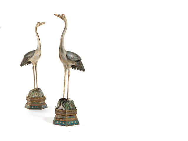 A magnificent and large pair of Imperial cloisonné enamel cranes 18th/19th century