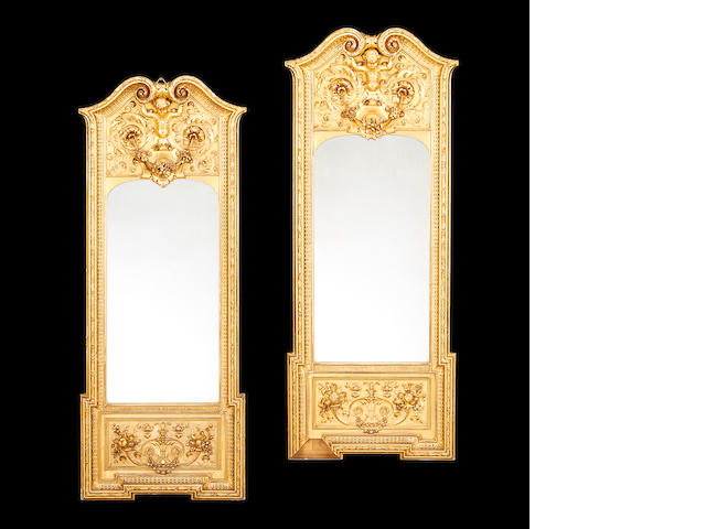 A pair of French late 19th century carved giltwood pier mirrors