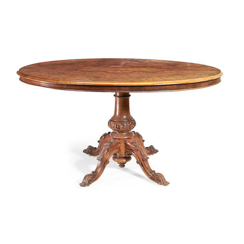 A Victorian walnut breakfast table