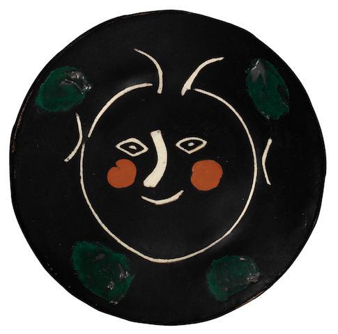 Pablo Picasso (Spanish, 1881-1973) Service visage noir 23.4cm (9 3/16in) diameter