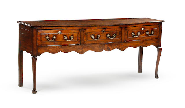 A mid-18th century elm low dresser