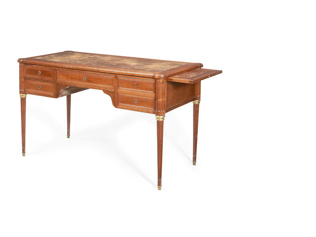 A late 19th century mahogany and gilt brass mounted bureau plat in the Louis XVI style