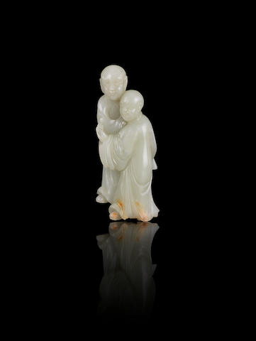 A pale green jade carving of two scholars 18th/19th century