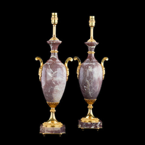 A pair of Louis XVI style Breche Violette marble urn lamp bases
