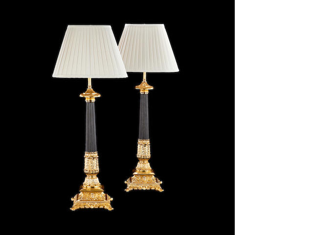 A pair of gilt and patinated metal Corinthian column lamp bases