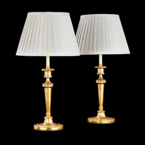 A pair of 19th century gilt metal candlesticks adapted as lamp bases