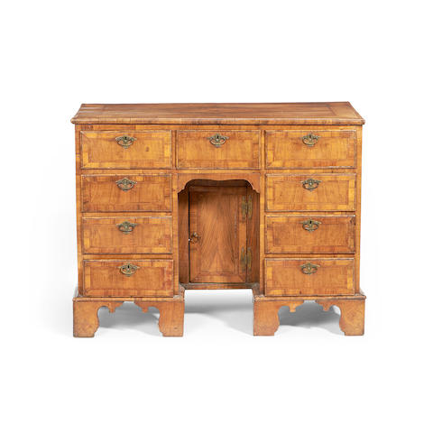 A 19th century walnut, crossbanded and feather banded desk in the early 18th century style retailed by S & H Jewell