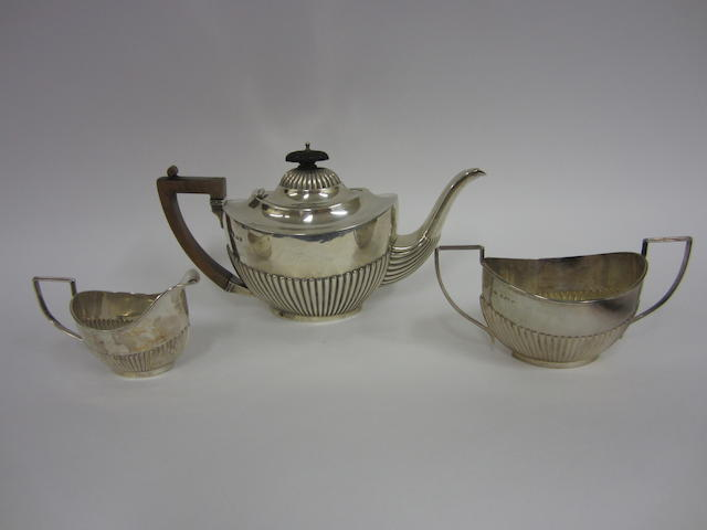 An Edwardian silver three-piece tea service Birmingham 1902