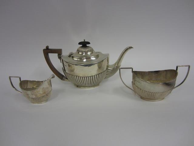 An Edwardian silver three-piece tea service Birmingham 1902