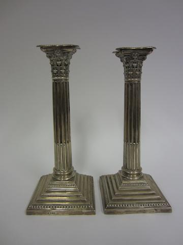 A Victorian silver pair of Corinthian column candlesticks, Sheffield 1900,
