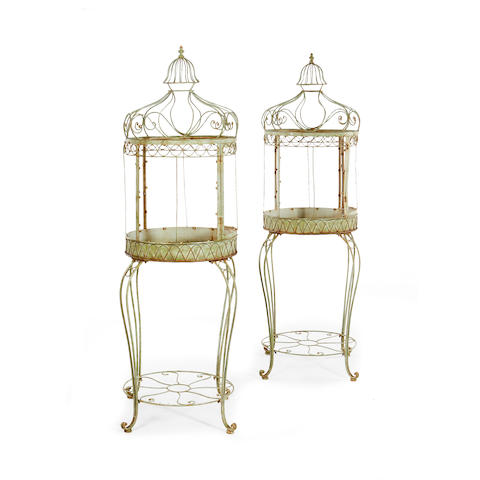 A pair of French early 20th century green painted wrought iron and wire planters in the form of birdcages