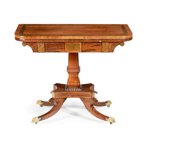 A Regency rosewood and cut brass inlaid card table
