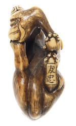 An ivory netsuke of a yama-inu (wild dog) By Tomotada, Kyoto, late 18th/early 19th century