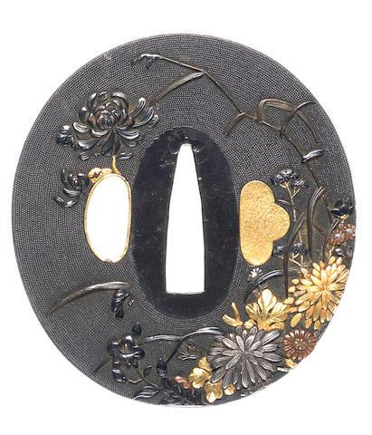 An Ishiguro-style shakudo tsuba 19th century
