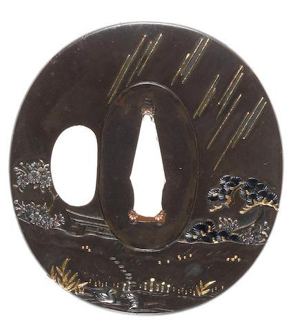 A dark shibuichi tsuba By Masatomo, 19th century