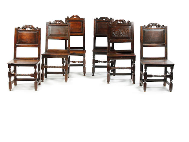 Six similar Charles II oak backstools Circa 1680