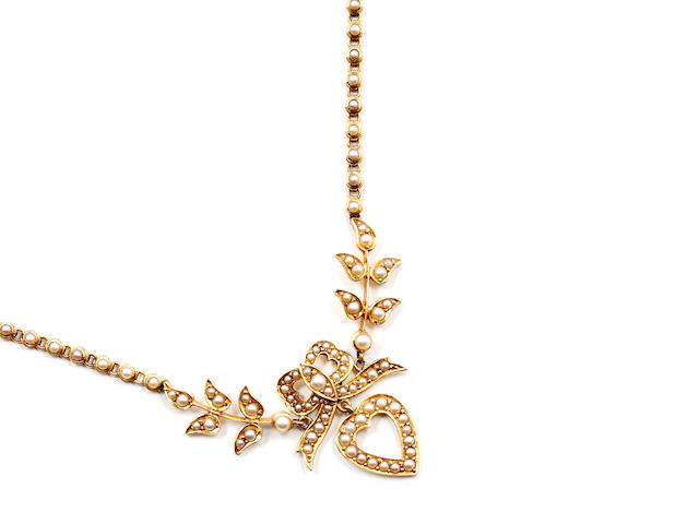 A late Victorian/Edwardian 18ct gold seed pearl pendant necklace