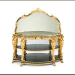 A late 19th/early 20th century giltwood, ebonised and composition display buffet in the Rococo revival style