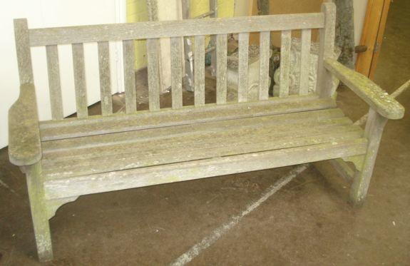 A slatted teak garden bench seat, 162cm.