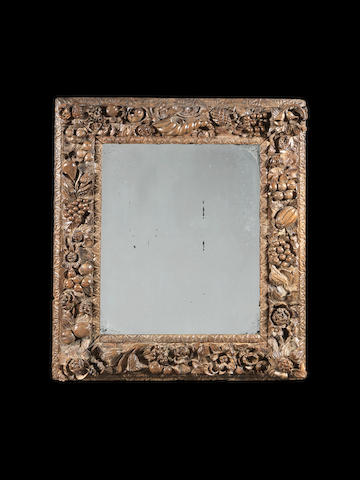 A late 17th century carved mirror frame