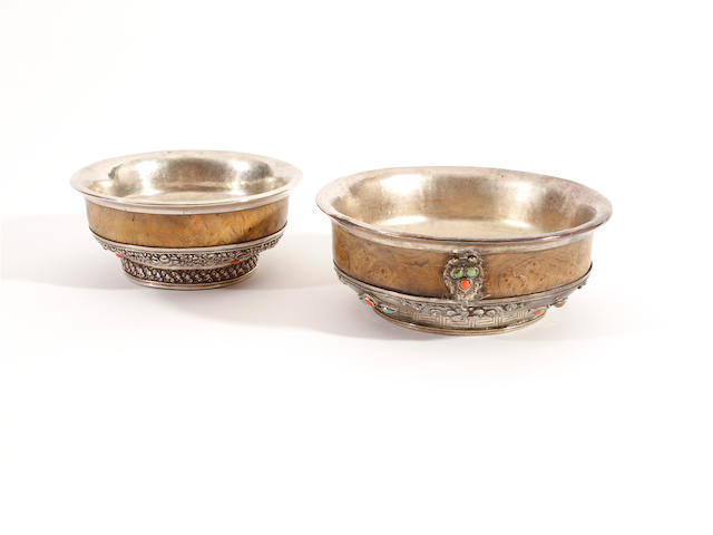 Two small Tibetan silver and wood bowls