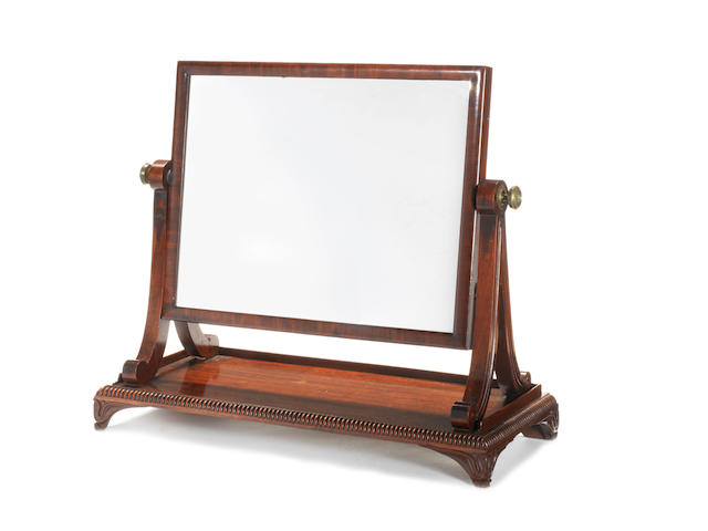 A William IV carved mahogany toilet mirror  attributed to Gillows