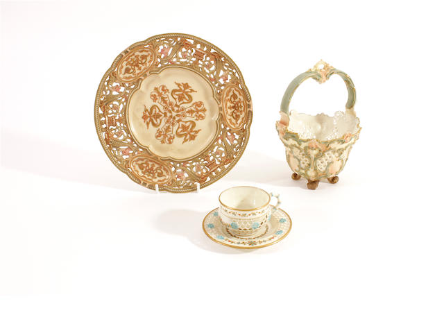 A Royal Worcester cabinet cup and saucer, a pierced plate and a basket, late 19th century