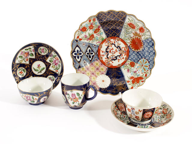 A Worcester trio, a cup and saucer and a plate, circa 1765-70
