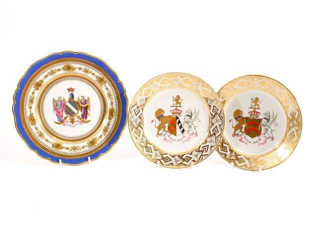A pair of Chamberlain small armorial plates and another plate, 19th century