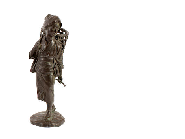 A Japanese bronze figure of a girl, 20th century