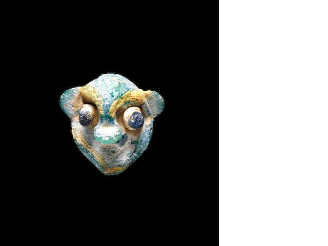 A Phoenician glass head bead