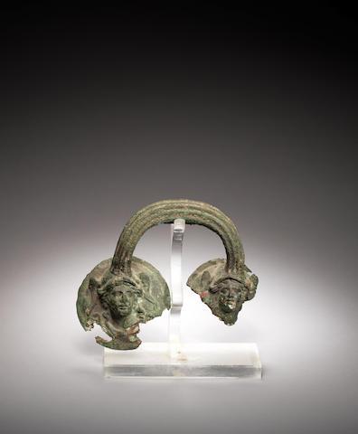 A Roman bronze vessel handle