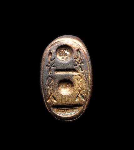 An Egyptian gilt bronze finger ring