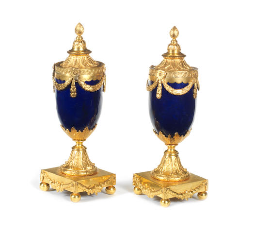 A pair of ormolu mounted blue enamel candle vases attributed to Matthew Boulton