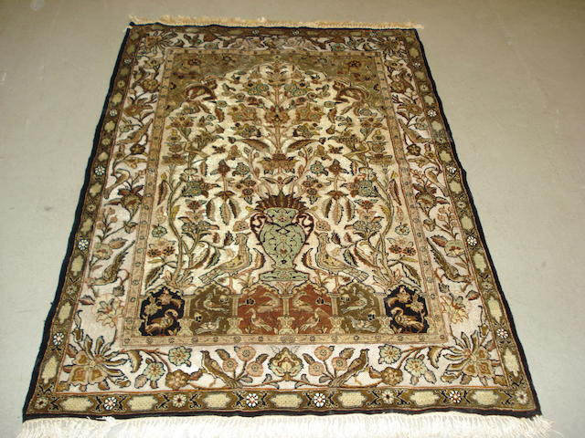 A silk and metal thread Ghom prayer rug, Central Persia, 146cm x 104cm