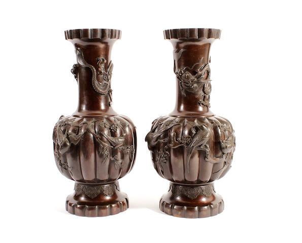 A pair of Japanese patinated bronze vases, circa 1900