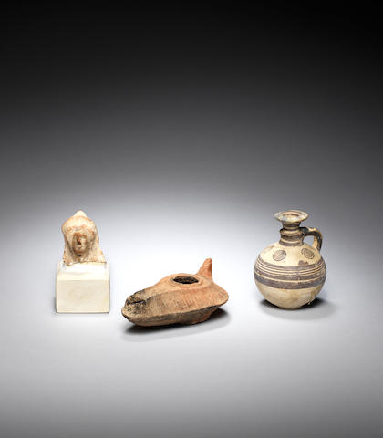 A group of 3 x ancient pottery items including a Cypriot flask, a Greek head and a Roman lamp